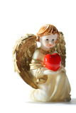 Little Gold Angel. Holly angel with heart on white royalty free stock image