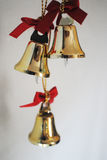 Little gold bells. Little gold Christmas bells with red ribbon Stock Photo