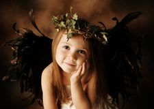 Little Gold and brown angel child Stock Photo