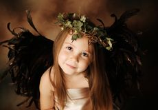 Little Gold and brown angel child Royalty Free Stock Image