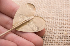 Little gold color heart shape in hand Stock Photo