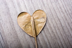 Little gold color heart shape in hand Royalty Free Stock Images