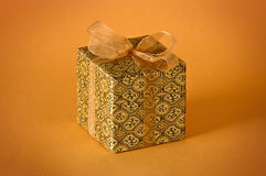 Little gold gift Stock Photography