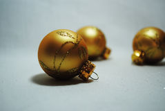 Little golden baubles. Three little golden Christmas baubles stock image