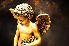 Little golden cherub stock photos