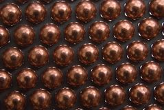 Little golden Metallic Magnetic balls Royalty Free Stock Images