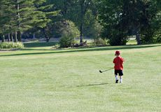 Little Golfer. Four-year old boy golfing on a big course. Bright, high-contrast day stock photos