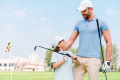 Little golfer with father. Stock Photos