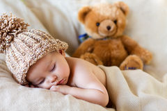 Little gorgeous baby boy with a big hat. And a teddy bear stock photography