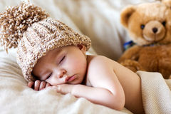 Little gorgeous baby boy with a big hat. And a teddy bear stock photo
