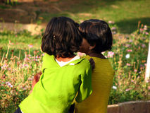 Little Gossips. Two small girls who are close friends in a gossip mode Stock Images