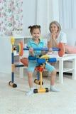 Little granddaughter doing exercise Stock Photo