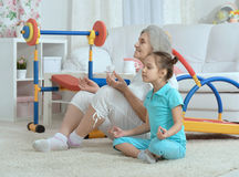 Little granddaughter doing exercise Royalty Free Stock Image