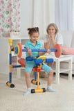 Little granddaughter doing exercise Royalty Free Stock Photo