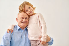 Little granddaughter hugging her grandfather Royalty Free Stock Images
