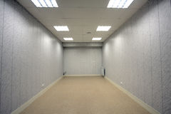 Little gray empty room, unfurnished, with plastic trim of the wa Stock Image
