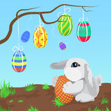 Little gray rabbit with the Easter eggs hanging on a branch vector illustration. Stock Images