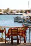 Little greek restaurant by the harbour. Greek restaurant with small tables looking out over the harbour royalty free stock photo