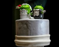 Little Green Aliens on Top of a Wedding Cake.  royalty free stock photography