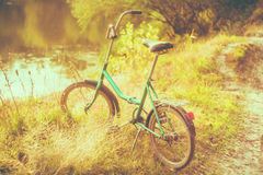 Little green bicycle Stock Images