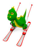 Little green dinosaur on skis. Little funny green dinosaur quickly descends ski steep mountains Royalty Free Stock Photography