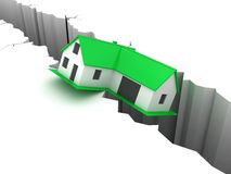 Little green falling house over a hole. Stock Photo
