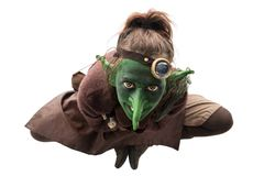 Little green goblin is sitting Royalty Free Stock Images