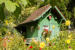 Little green house in garden Stock Photos