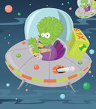 Little green man in his flying saucer. Royalty Free Stock Photos