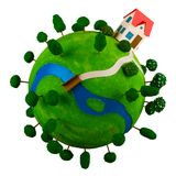 Little green planet with toy house. Stock Photography