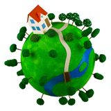 Little green planet with toy house. Royalty Free Stock Photography