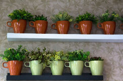 Little green plants wall decoration. Stock Photo