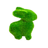 Little green rabbit on wooden floor, made from artificial grass Stock Images