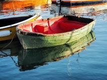 Little Green Skiff. Small skiff with reflections at the harbour on a sunny september morning Stock Photography