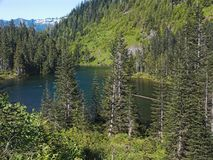 Little Greider Lake (close view). A full view of Little Greider Lake in the Cascade Mountains of Washington State, USA stock photos