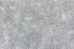 Little grey pebbles surface with abstract stains. Royalty Free Stock Photos