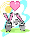 Little grey rabbit gives a balloon in the shape of a heart Stock Photography