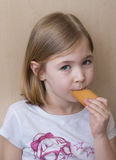 Little gril eating biscuit Royalty Free Stock Photography