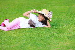 Little gril on green grass Stock Photography