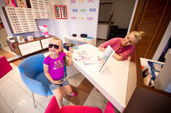 Little girl and optician in a shop Stock Photography