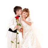 Little groom kissing little bride Stock Photography