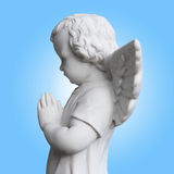 Little guardian angel. Over turquoise background Stock Image