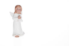 Little guardian angel over white background. Little white guardian angel over white background. Vintage style christmas decoration Royalty Free Stock Photo