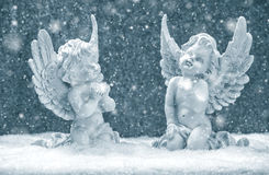 Little guardian angels in snow. christmas decoration Stock Photos