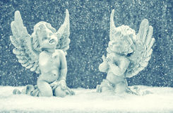 Little guardian angels in snow. christmas decoration Royalty Free Stock Image