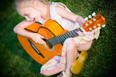 Little Guitar Player Royalty Free Stock Photos