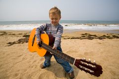 Little guitarist Stock Images
