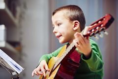 Little guitarist Royalty Free Stock Images
