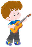 Little guitarist. Boy playing his small guitar Stock Photos
