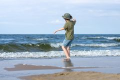 A little guy on the sandy beach. Royalty Free Stock Image